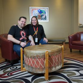 Neil Fowler, Project Assistant at the Immunodeficiency Clinic & Aboriginal Health Program at St. Paul's, and Carol Kellman, a Registered Nurse and an Aboriginal Nurse Practice Leader with Providence Health Care, sit for a photograph in the All Nations Sacred Space.